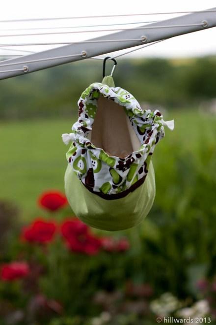 Homemade clothes peg bag hanging open