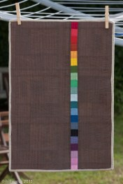 Quilt back; rainbow strip on neutral background