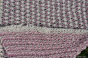 Front and reverse detail of coloured slip stitches in knit blanket