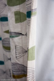 Detail of edge of curtain fabric and blackout lining
