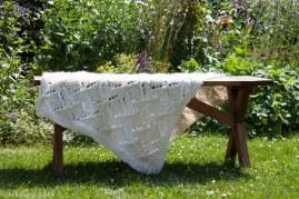 Umaro blanket draped on bench