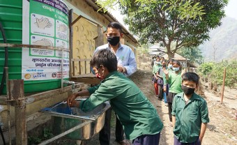 Students enjoy soap and water before entering class