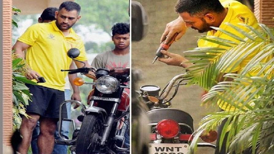 Dhoni repairing his bike