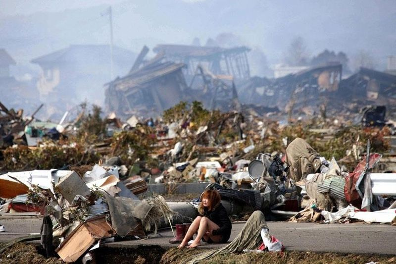 a-japanese-woman-cries-after-earthquake-and-tsunami-struck-japan-in-march-2011