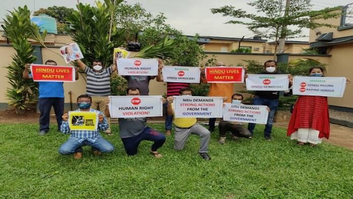 विदेश में बसे भारतीयों का बंगाल हिंसा के विरोध में प्रदर्शन