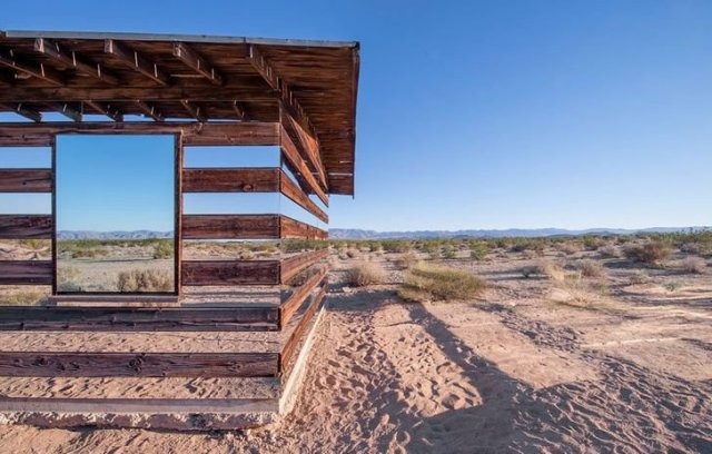 Mirrored Wooden Shelter