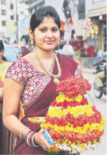 woman holding Bathukamma