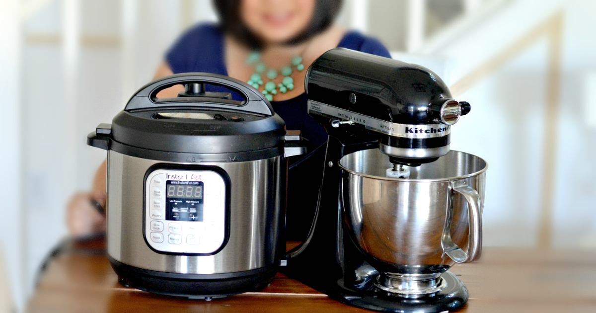 a pressure cooker and a kitchenaid mixer side by side