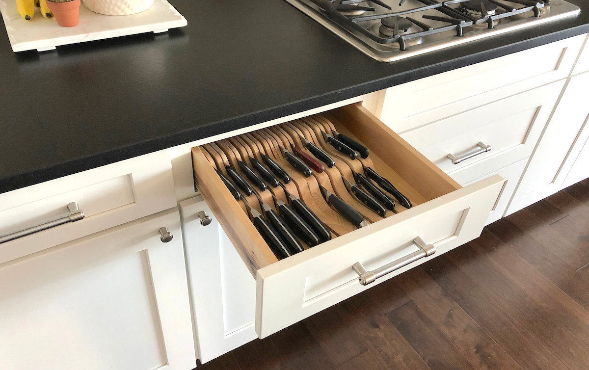side view of the open drawer with knife organizers