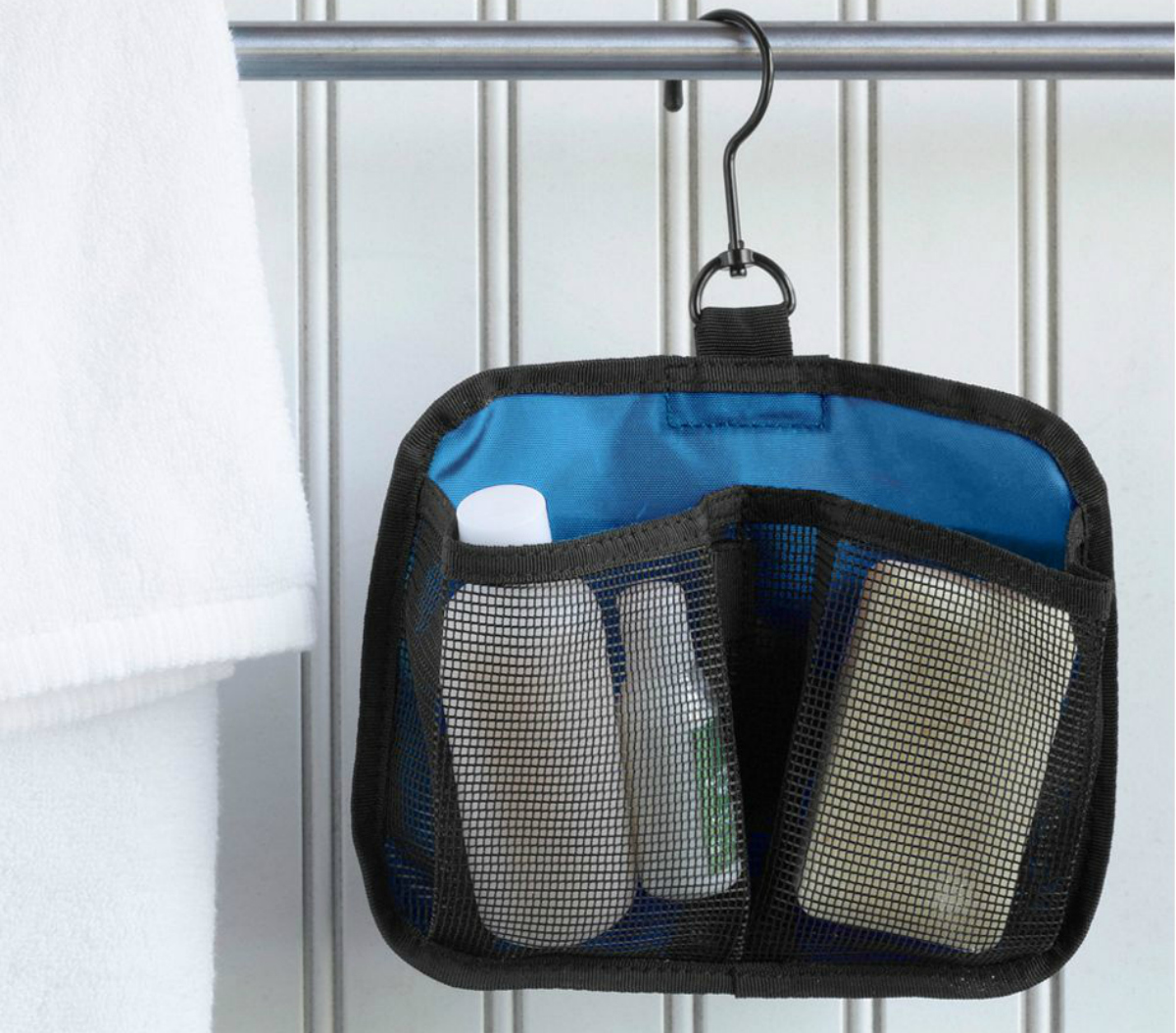 travel organizer hanging from a shower curtain rod