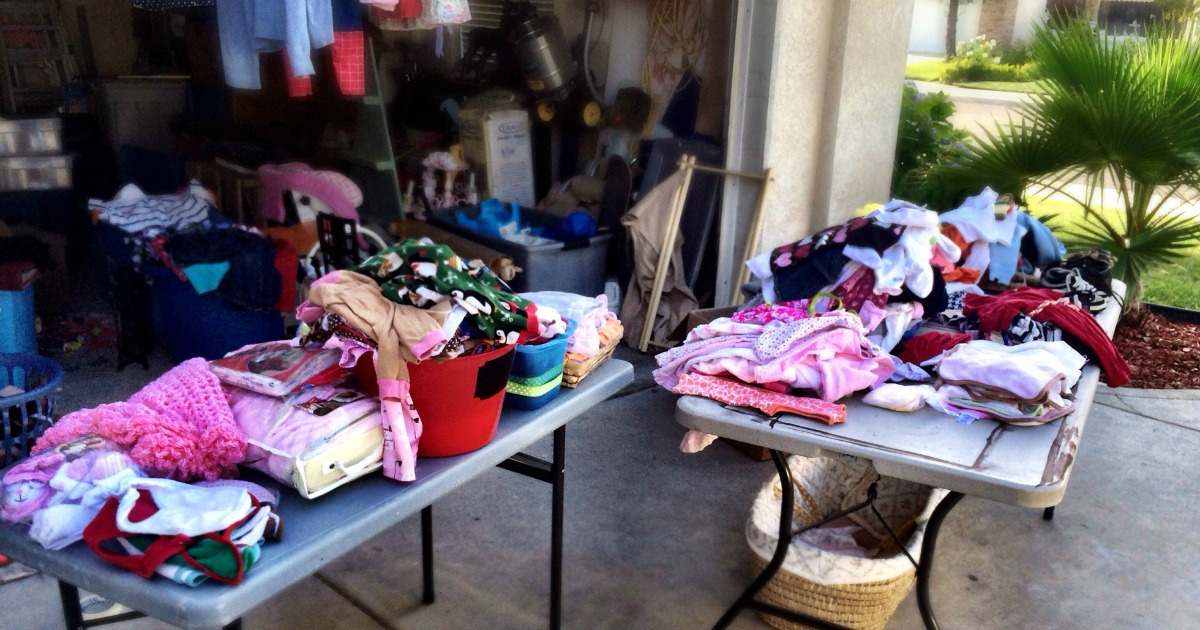 yard sale tables covered in clothing