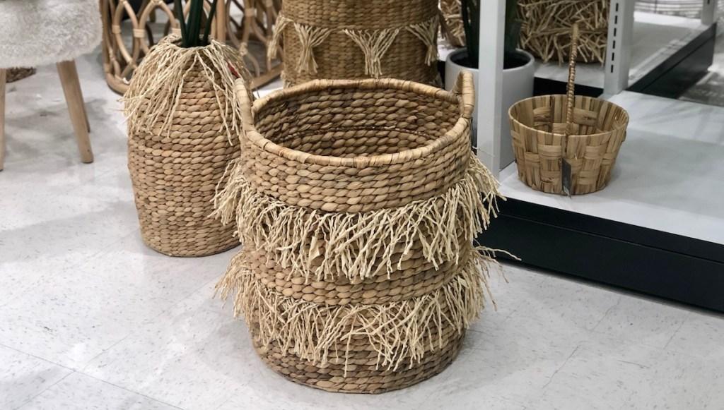 natural colored fringe basket on floor