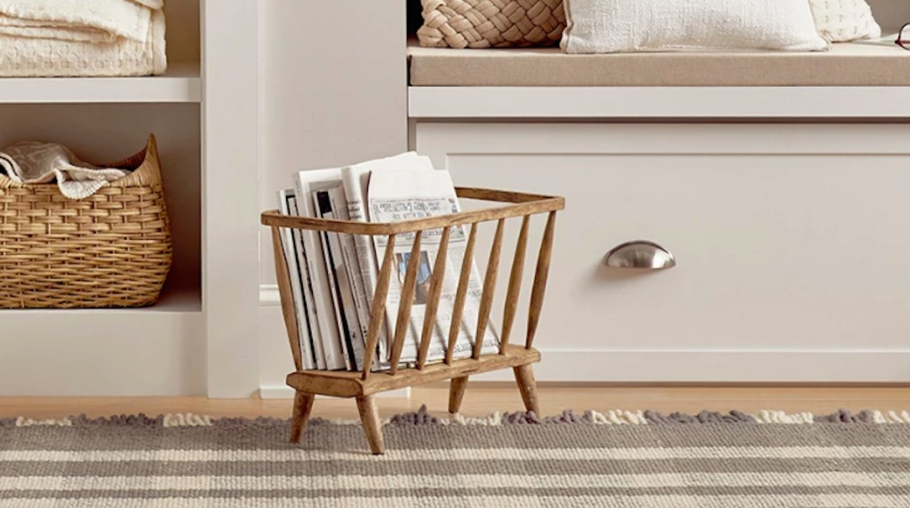 wood magazine holder sitting on the floor in a house