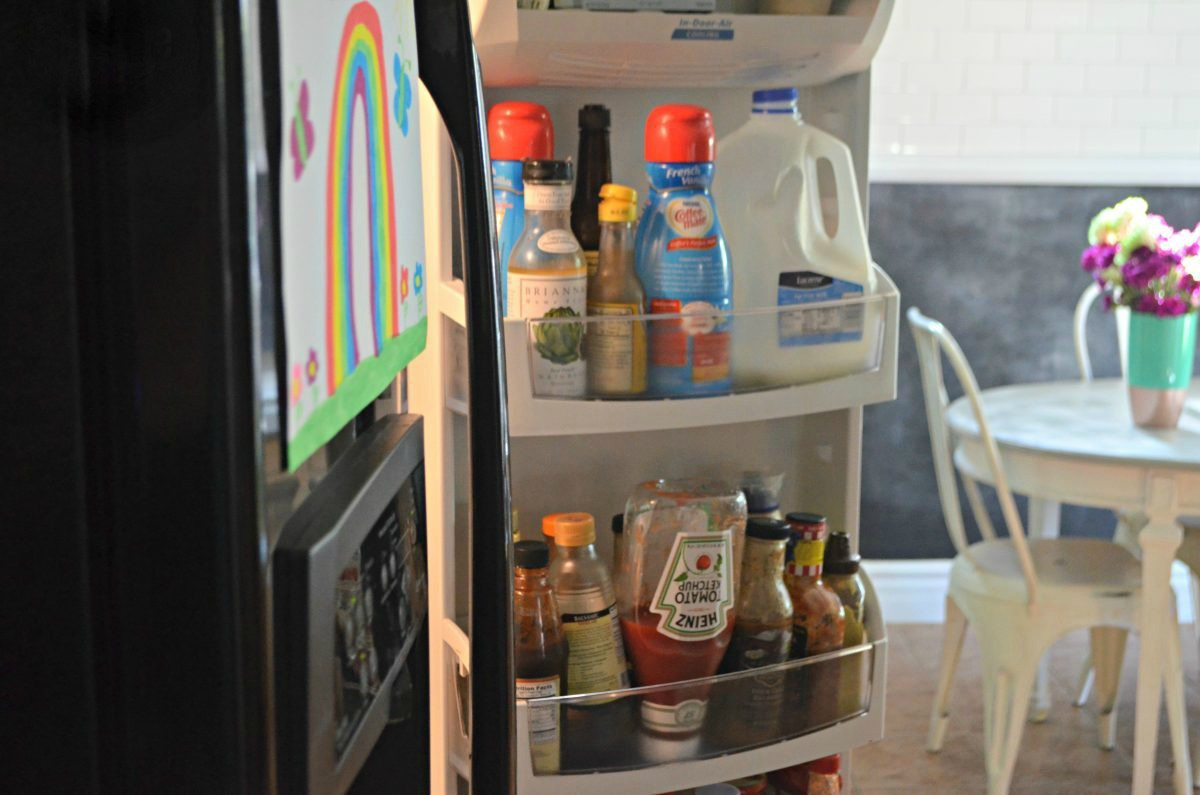 open refrigerator with condiments in the door