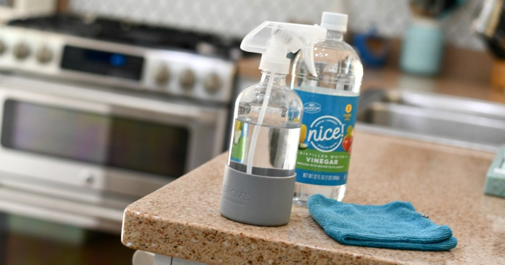 glass bottle from grove with vinegar cleaning solution