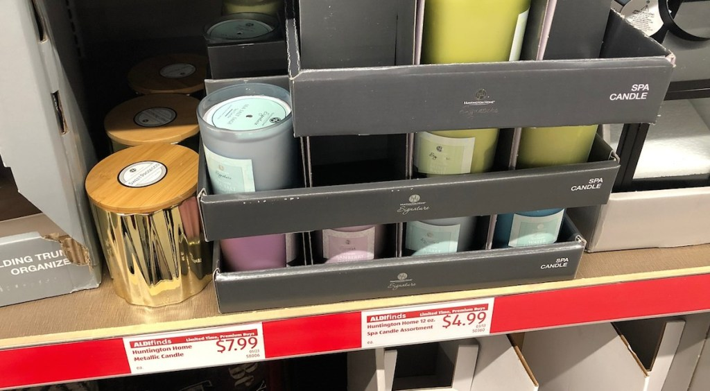 various candle on a store shelf gold blue green and purple