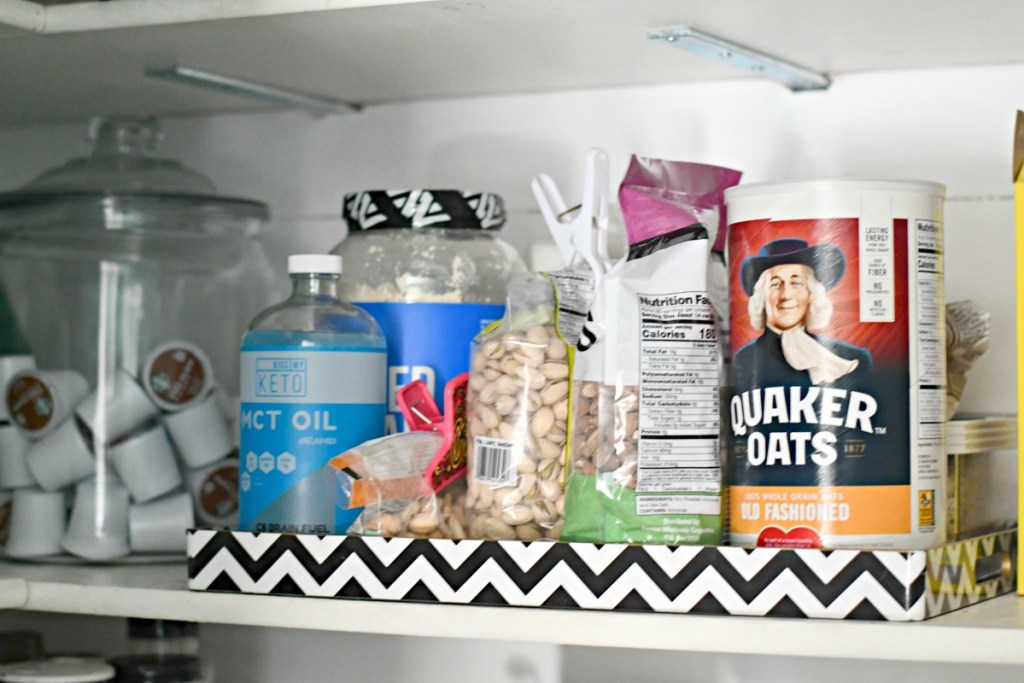 organizing using trays in the pantry