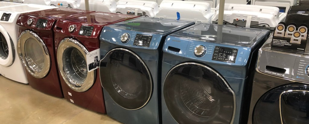 white red blue washers and dryers machines in store on the floor
