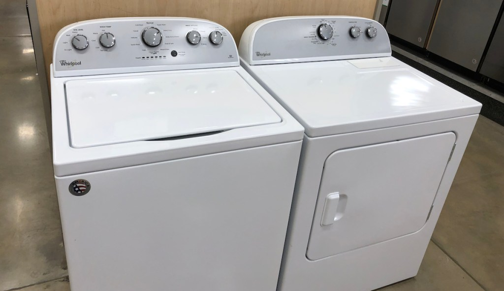 white top loading washing machine and matching white dryer appliances