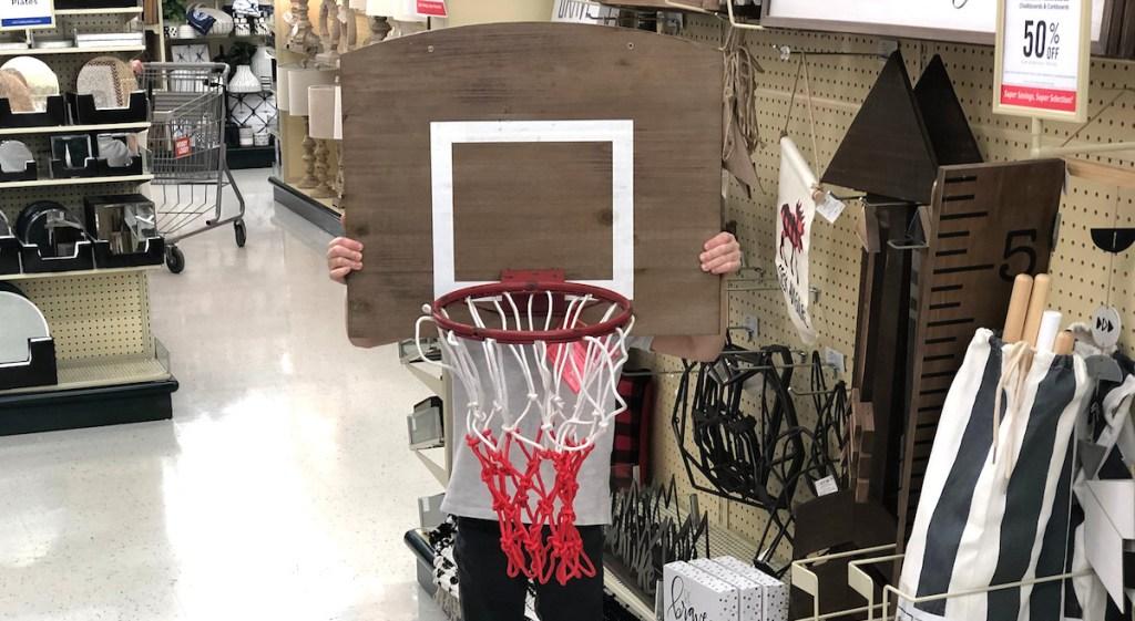 boy holding basketball hoop