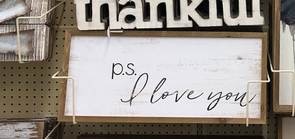 p.s. I love you white distressed framed wooden print hanging on store shelf