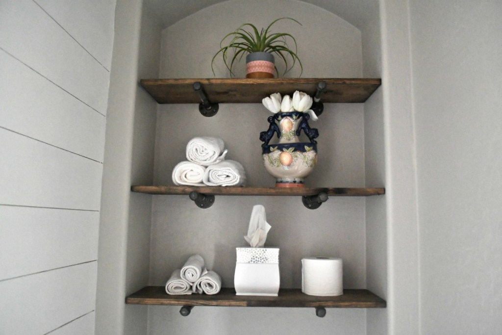 diy bathroom pipe shelving above the toilet for storage
