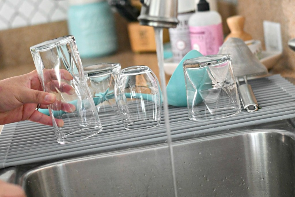 hand cleaning glass drinking cup