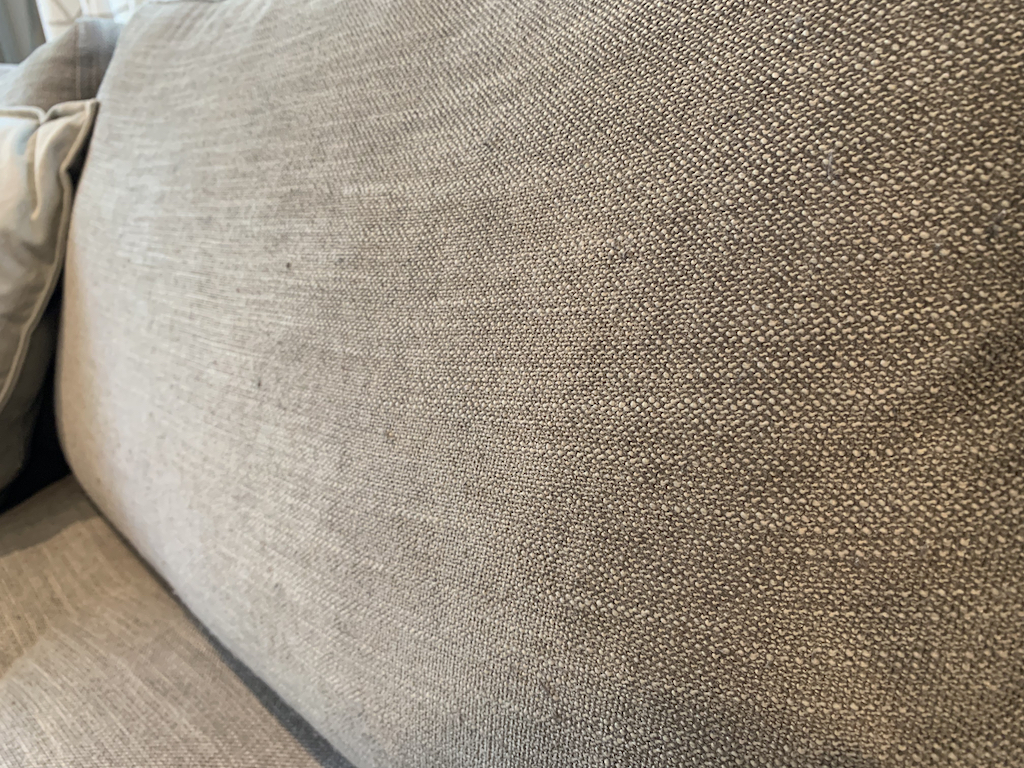 close up of grey couch cushion
