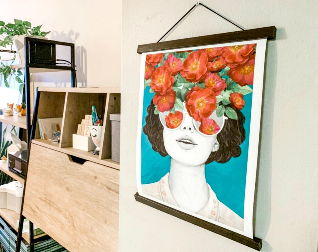 hanging picture of woman and flowers on wall