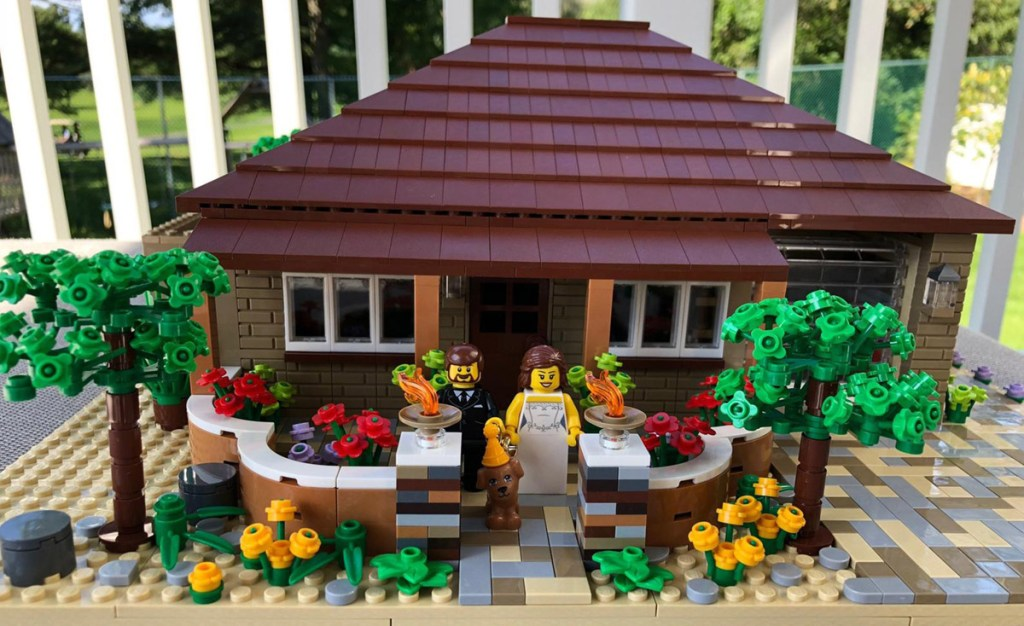 LEGO house with minifigure couple on porch