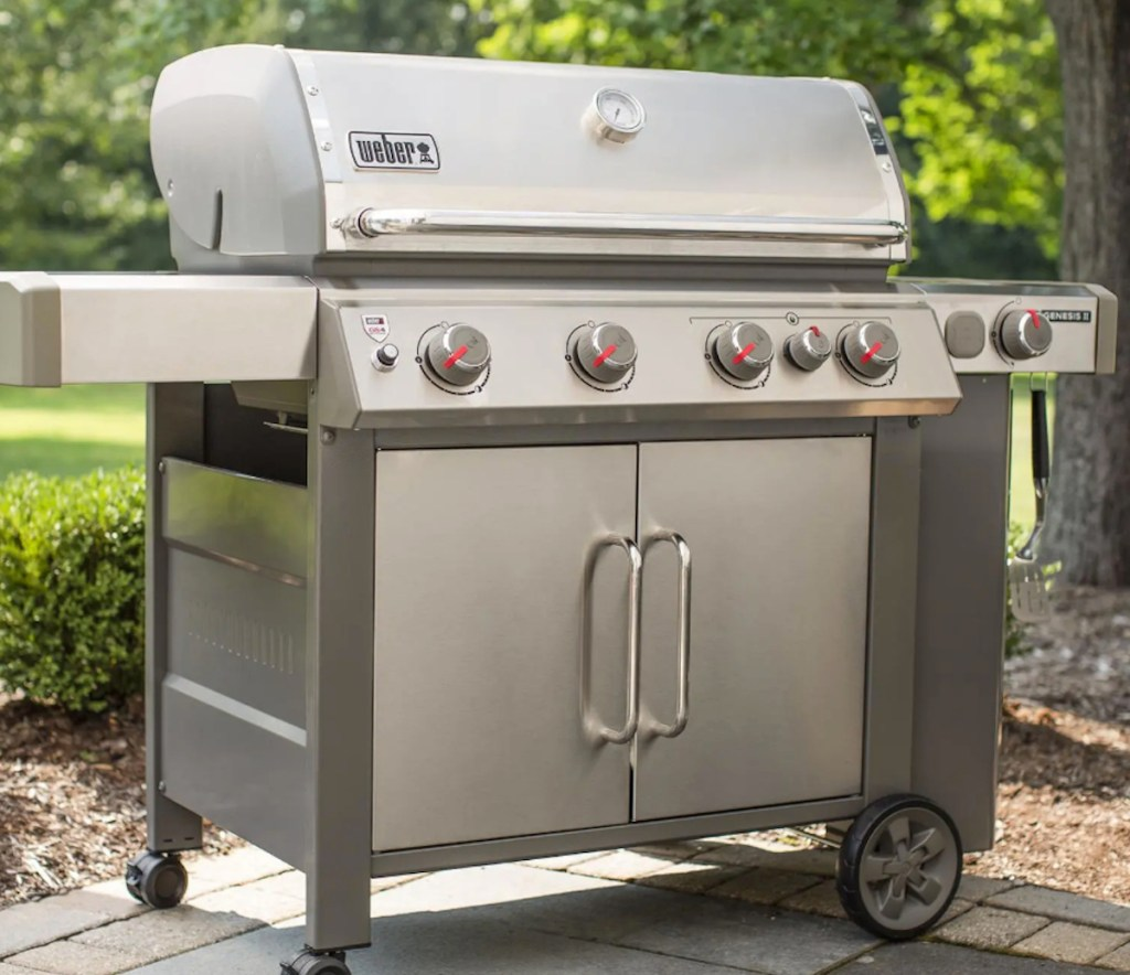 stainless steel weber grill sitting outside