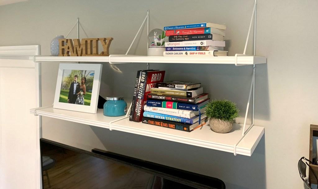 Collin's wall shelves displaying home decor
