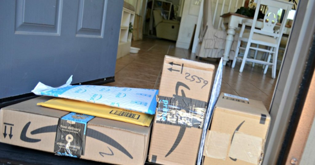 Amazon boxes stacked on front door