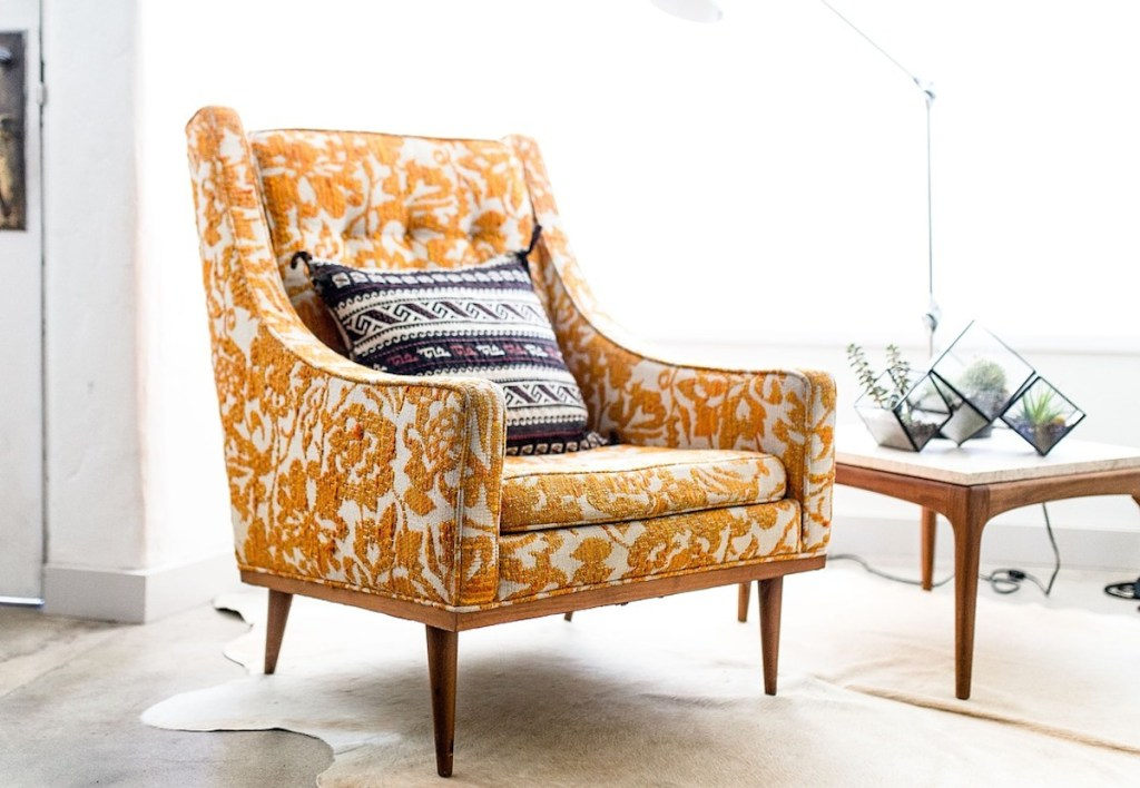 orange and white paisley floral accent chair with sunlight