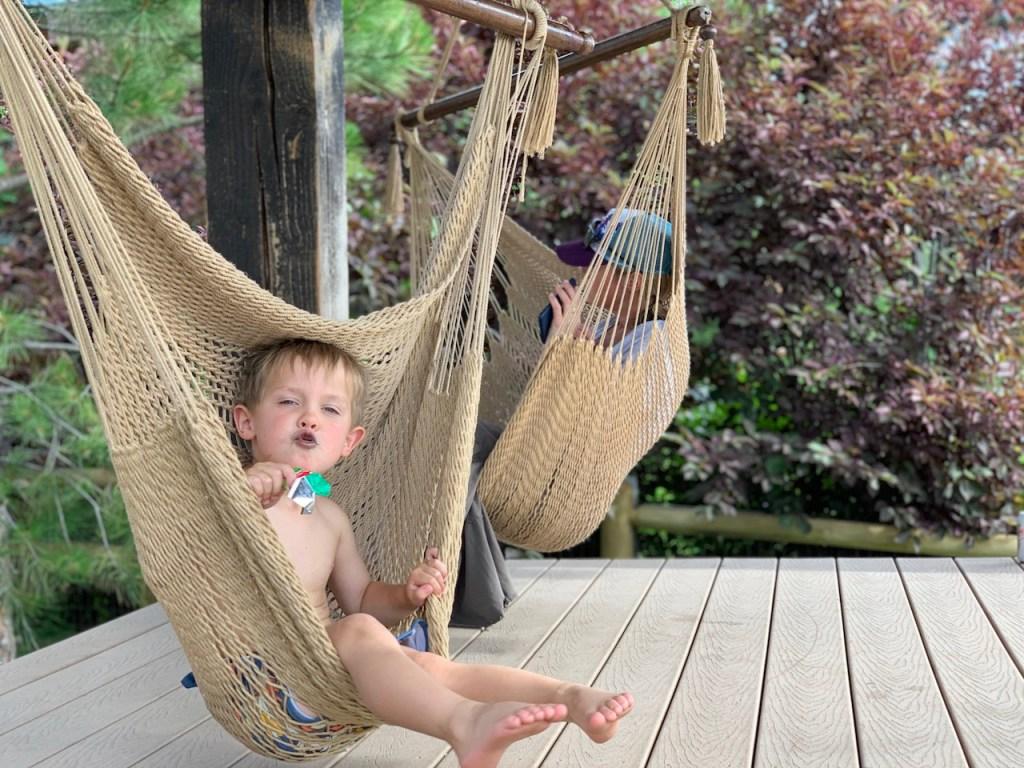 kid and mom sitting in hammock swings