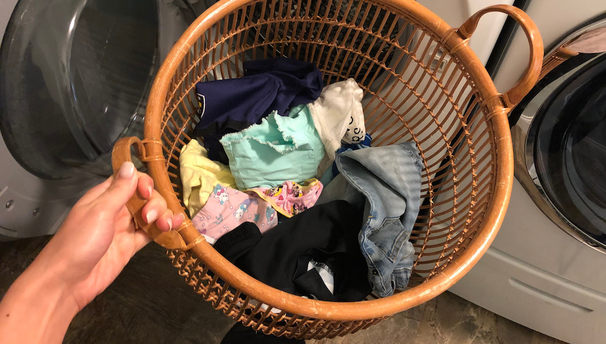 laundry basket with various colors of clothing inside