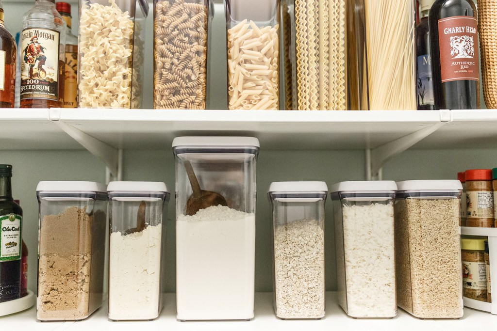 two rows of organized dry foods in oxo plastic containers