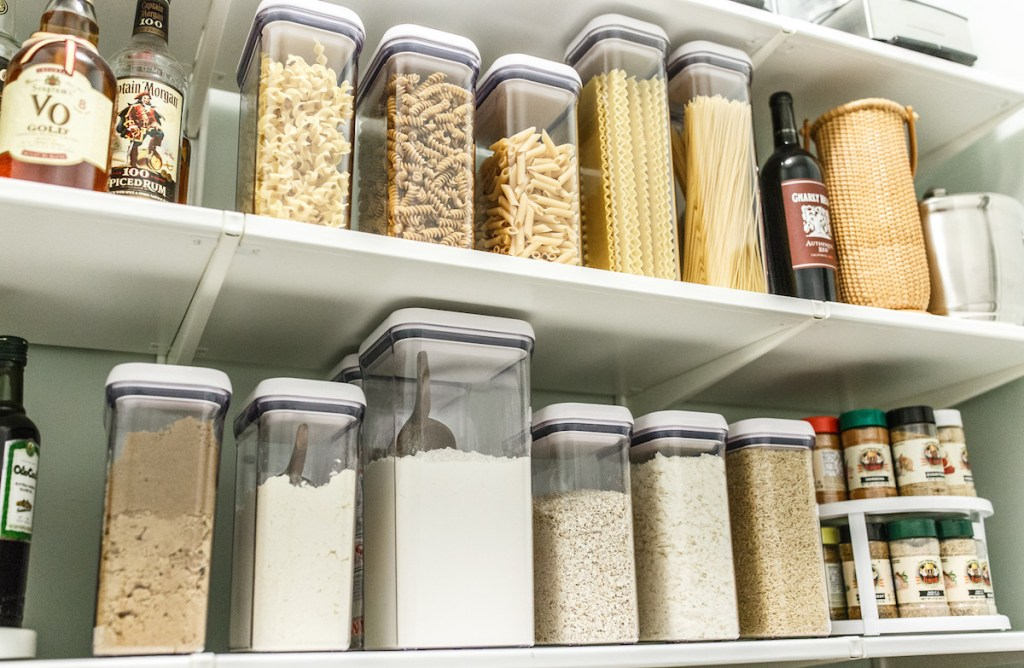 clean oxo containers on pantry shelf