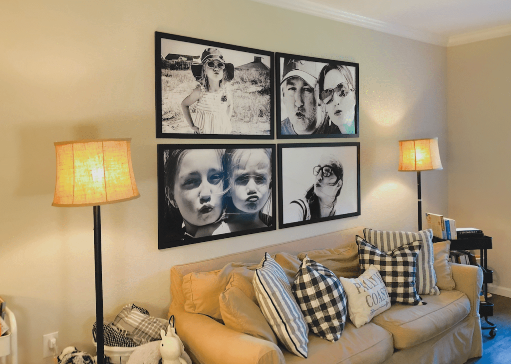 family photo gallery wall above couch in living room