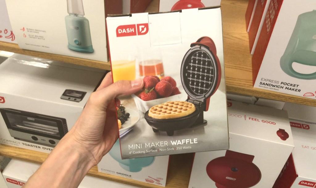 hand holding Dash Mini Waffle Maker box