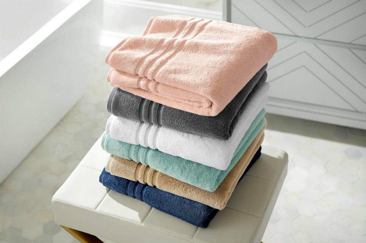 home decorators collection different color bath towels on counter