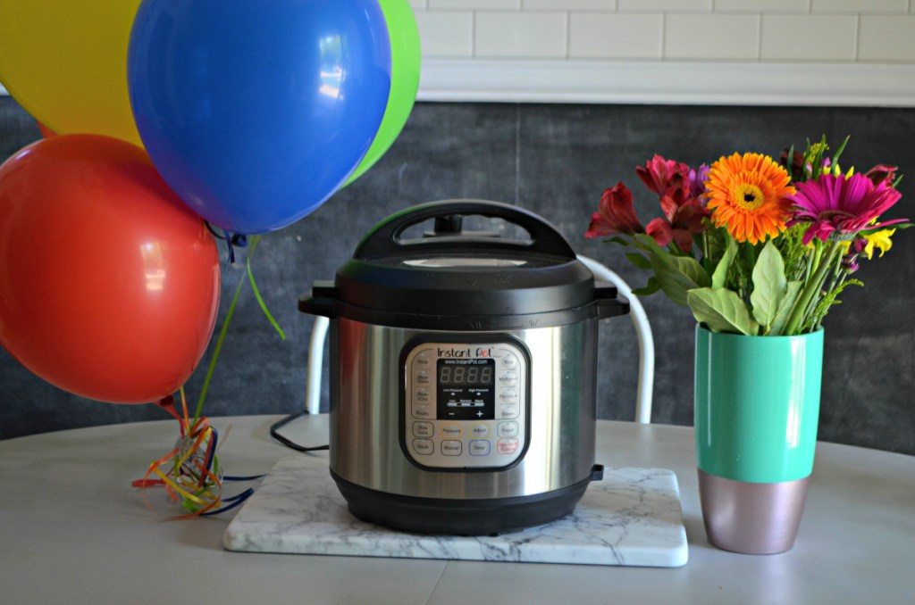 Instant pot next to balloons and flowers