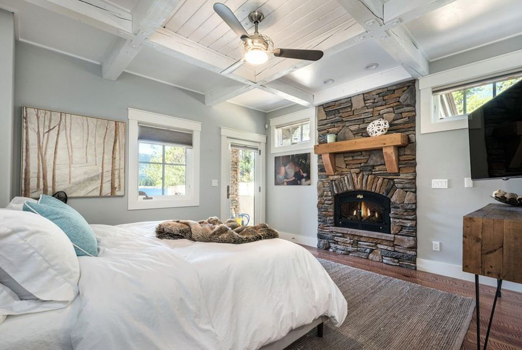 cozy bedroom with fireplace on