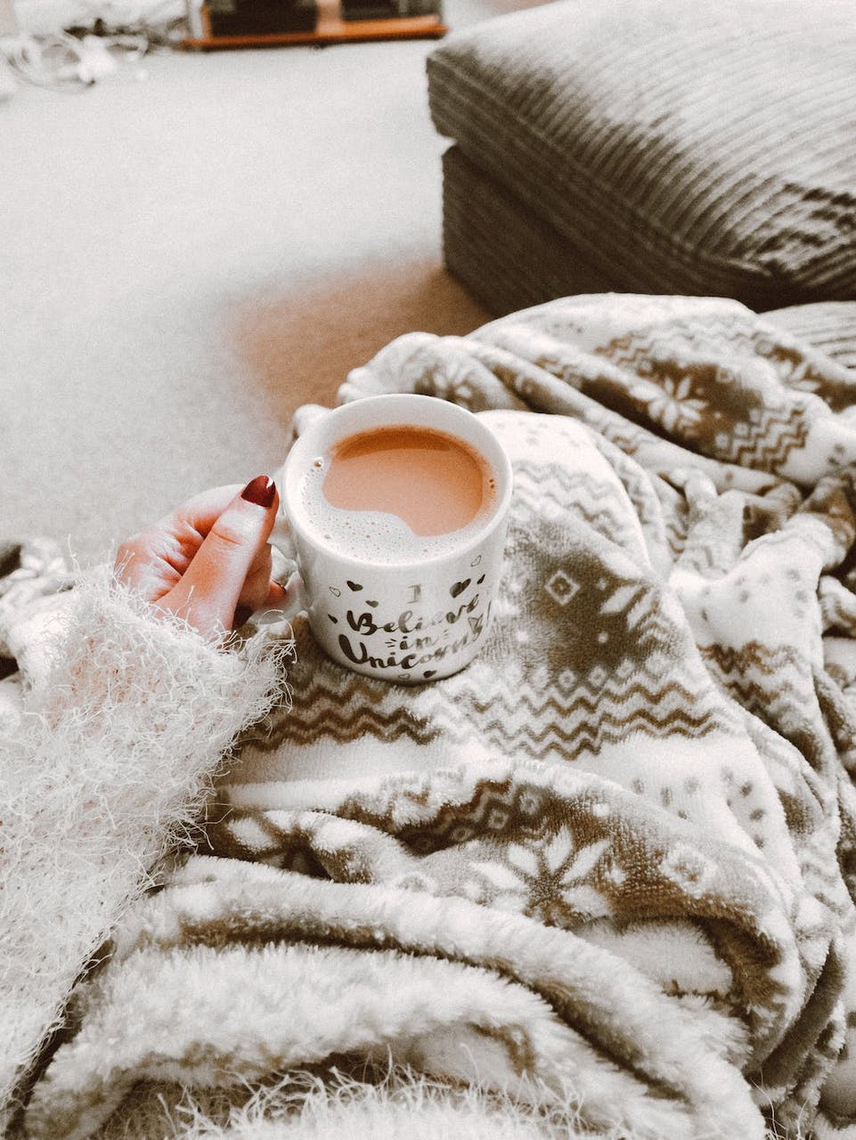 relaxing on couch with coffee and blanket
