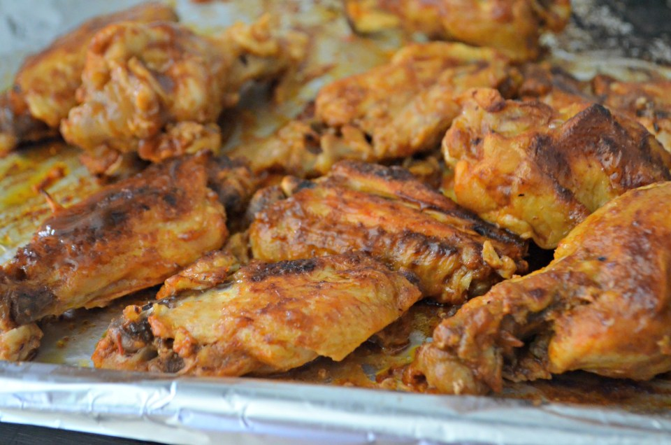 Keto Slow Cooker Buffalo BBQ Wings - closeup of the wings on a baking sheet