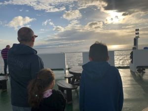 Hip2trek Family stood on ferry looking at the sea