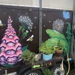 Hand painted flowers on the side of the converted horsebox