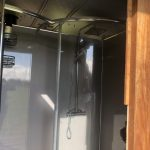 View of shower inside converted horsebox