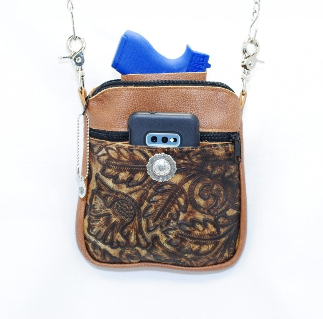 handgun and cell phone in hip bag holster