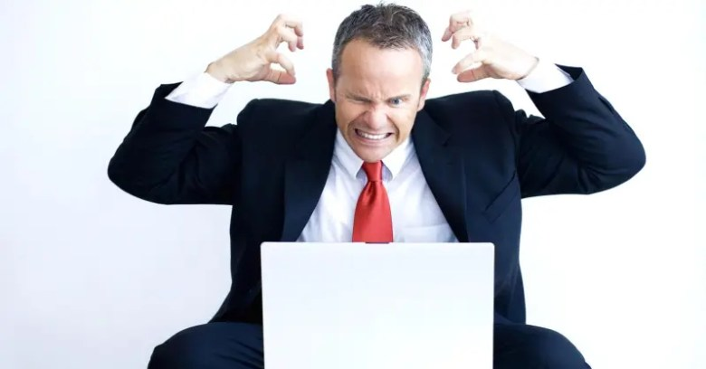 100665481-businessman-angry-working-at-laptop-gettyp.1910x1000